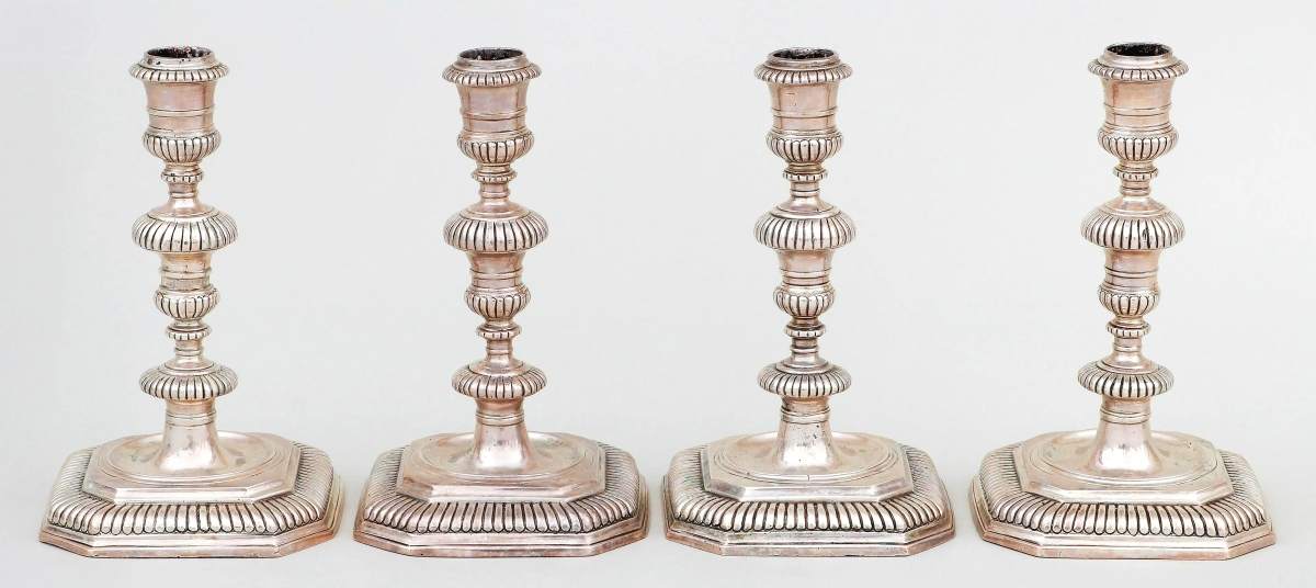 """London silversmith Benjamin Sanders produced this matched set of four candlesticks in 1740-1741. The firm wrote, """"Although dating from the early 1740s, the set is fashioned in the earlier William and Mary style."""" The set brought $21,000."""