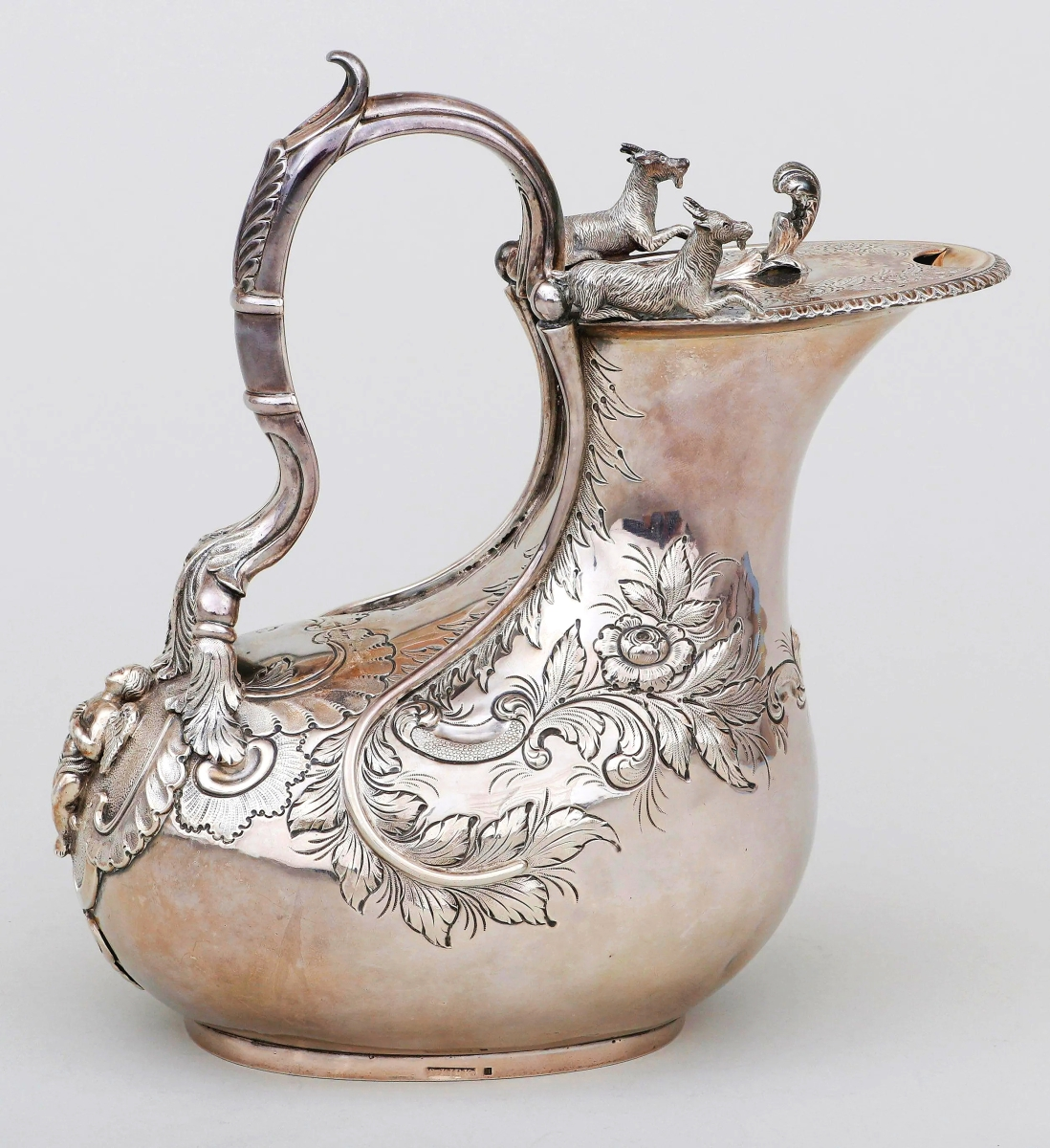 """Auctioneer Jean-Paul Napoli noted that Samuel Kirk's askos-form ewer received the most chatter in the presale run up. In a large size, at 10 inches high, the work sold as the second highest lot in the sale, earning $34,800. The goats atop reference the Greek askos form, wine jugs traditionally made from goatskin. This work was exhibited at the Baltimore Historical Society's 1993 show, """"Classical Maryland, 1815-1845: Fine and Decorative Arts from the Golden Age."""" The firm wrote, """"This is one of finest classical creations to come from early Nineteenth Century Baltimore."""" They noted its """"elaborate chasing, floral repousse work and detailed cast elements on the body... [including] a high-relief winged angel standing on a stippled background at the handle terminal."""""""