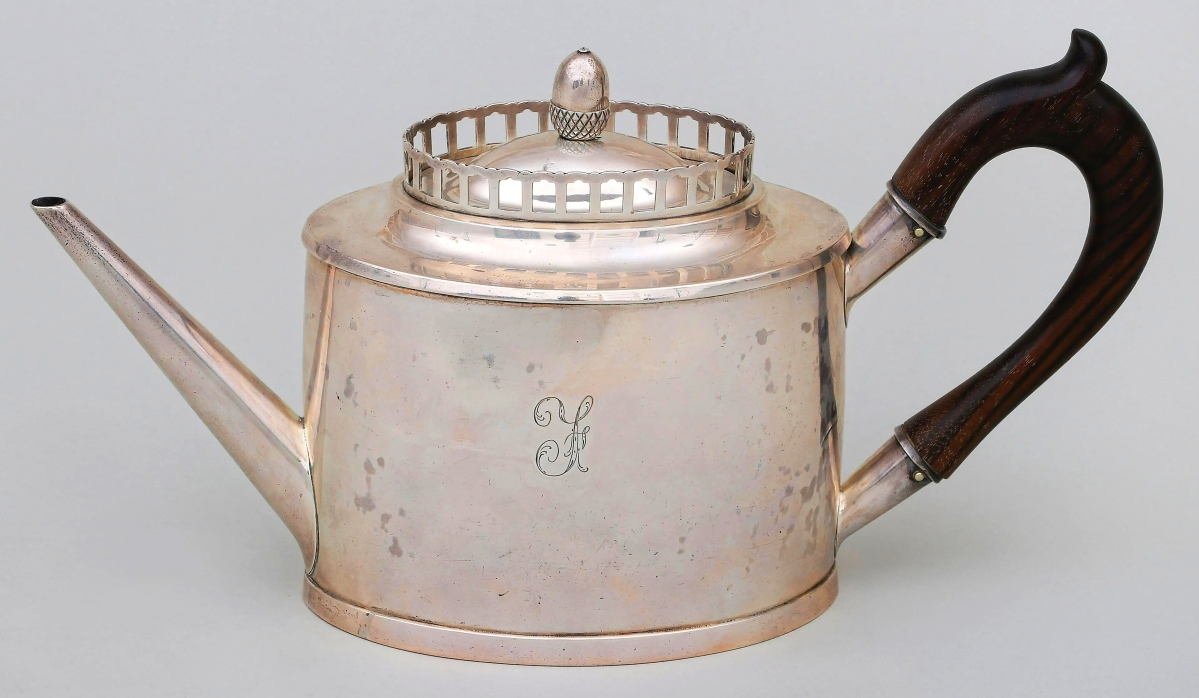 """Tying for the third highest priced lot in the sale at $30,000 was a teapot by Kentucky silversmith Asa Blanchard. It was monogrammed with the letter """"F,"""" which may have stood for the early Virginia Fouchet family, from whose collection this had early provenance to. It was the first time the teapot, circa 1795, had been offered with the correct attribution. It had previously been exhibited twice with the attribution to Archibald Bennett — the confusion stemming from the """"AB"""" mark to the bottom. The firm noted that singular letter monograms by surname were preferred in early Virginia silver, more so than in other states."""