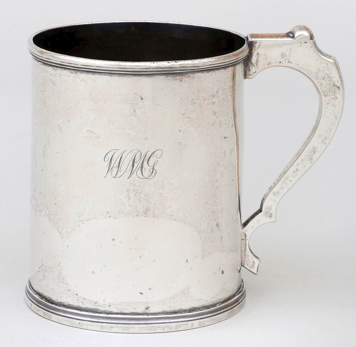 Simple in form, but high in price was this coin silver cann by Kentucky silversmith Asa Blanchard that brought $22,800. The firm noted that at 5 inches high, this was one of the of the largest and finest Blanchard canns known.