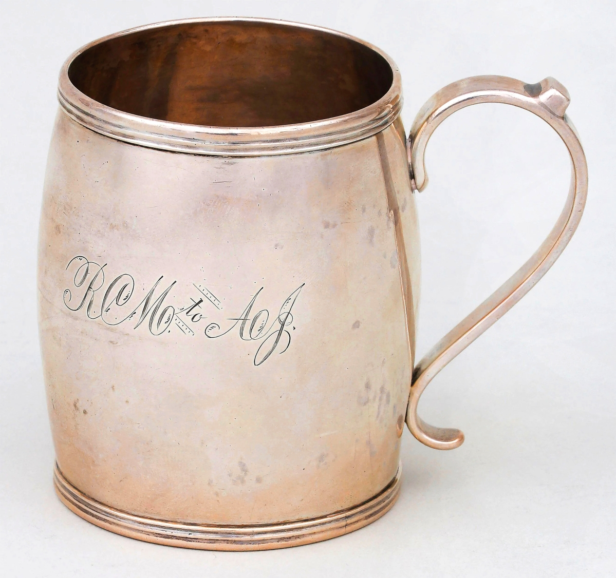 """Lexington, Ky., silversmith Thomas Gray produced this fine barrel-form mug circa 1820. It was likely a gift; the monogram reading """"RCM to AJ."""" It sold for $21,000."""