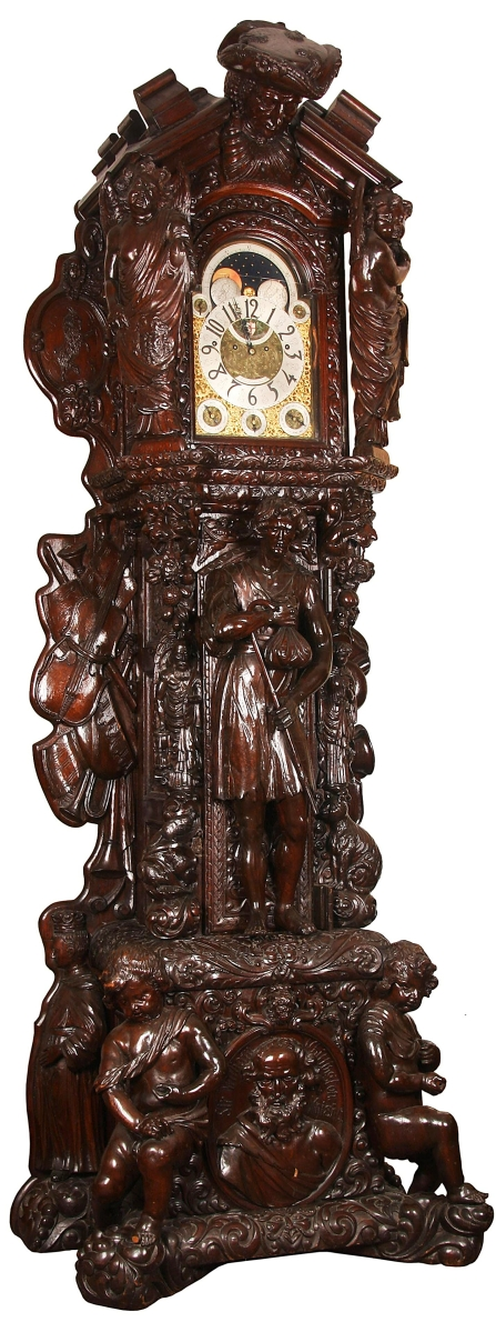 The monumental English carved oak tall case clock may have been made to tell time but it was also a feast for the eyes, with a pair of 3-foot-tall putti at the base flanking a central medallion of Sir William Whittington, a date of 1793 and much more. It struck $127,050.