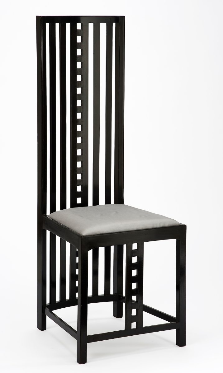 Chair of design for the writing desk for The Hill House, designed by Charles Rennie Mackintosh and made by Alex Martin, 1904-05. Ebonized wood, with modern upholstery. Glasgow Museums, given by Mr W. Sommerville Shanks, RSA, 1940. ©CSG CIC Glasgow Museums Collection. Courtesy American Federation of Arts.