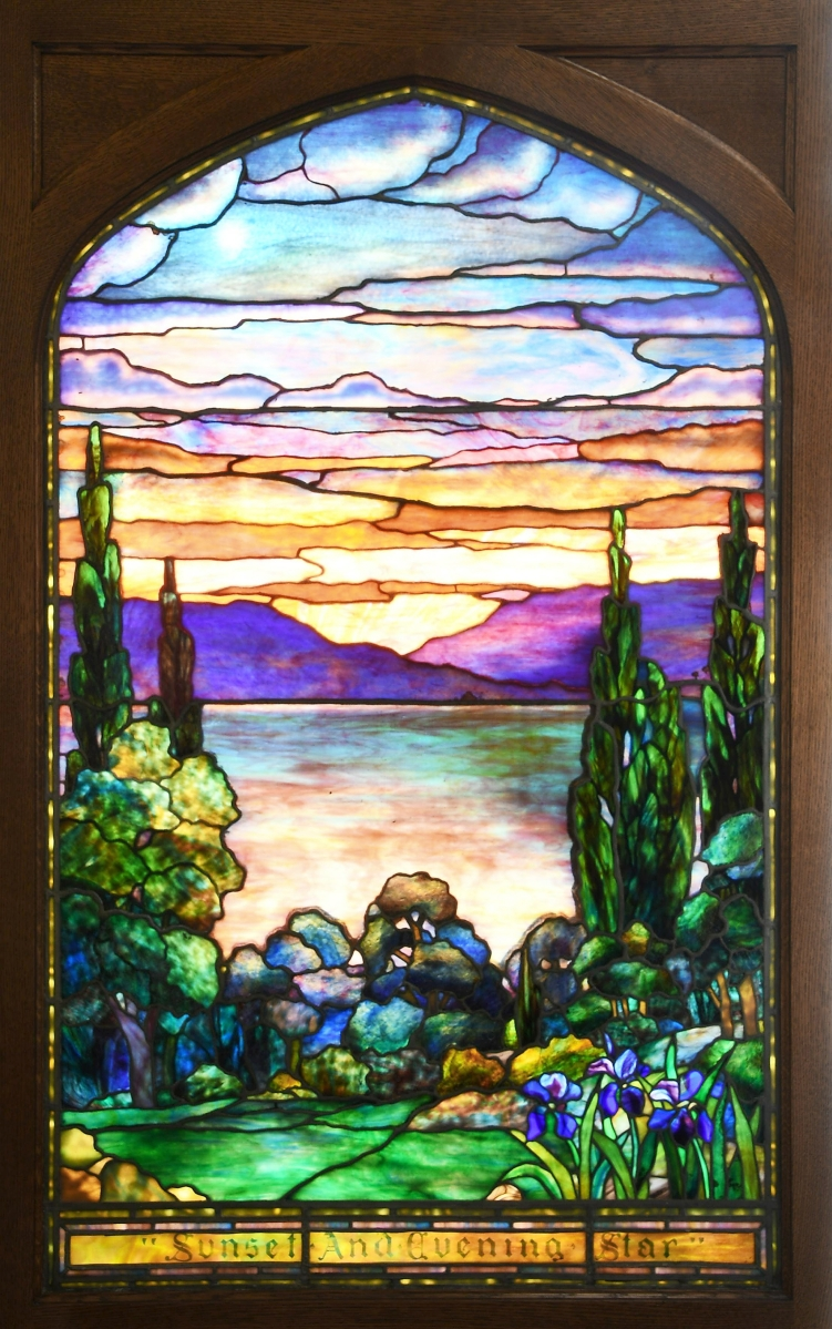 """The sale's first session was led by a Tiffany Studios """"Sunset and Evening Star"""" leaded and stained glass window, circa 1910, measuring 49¾ by 30½ inches. It blew away its $40/60,000 estimate to take $139,150, going to an out-of-state collector."""