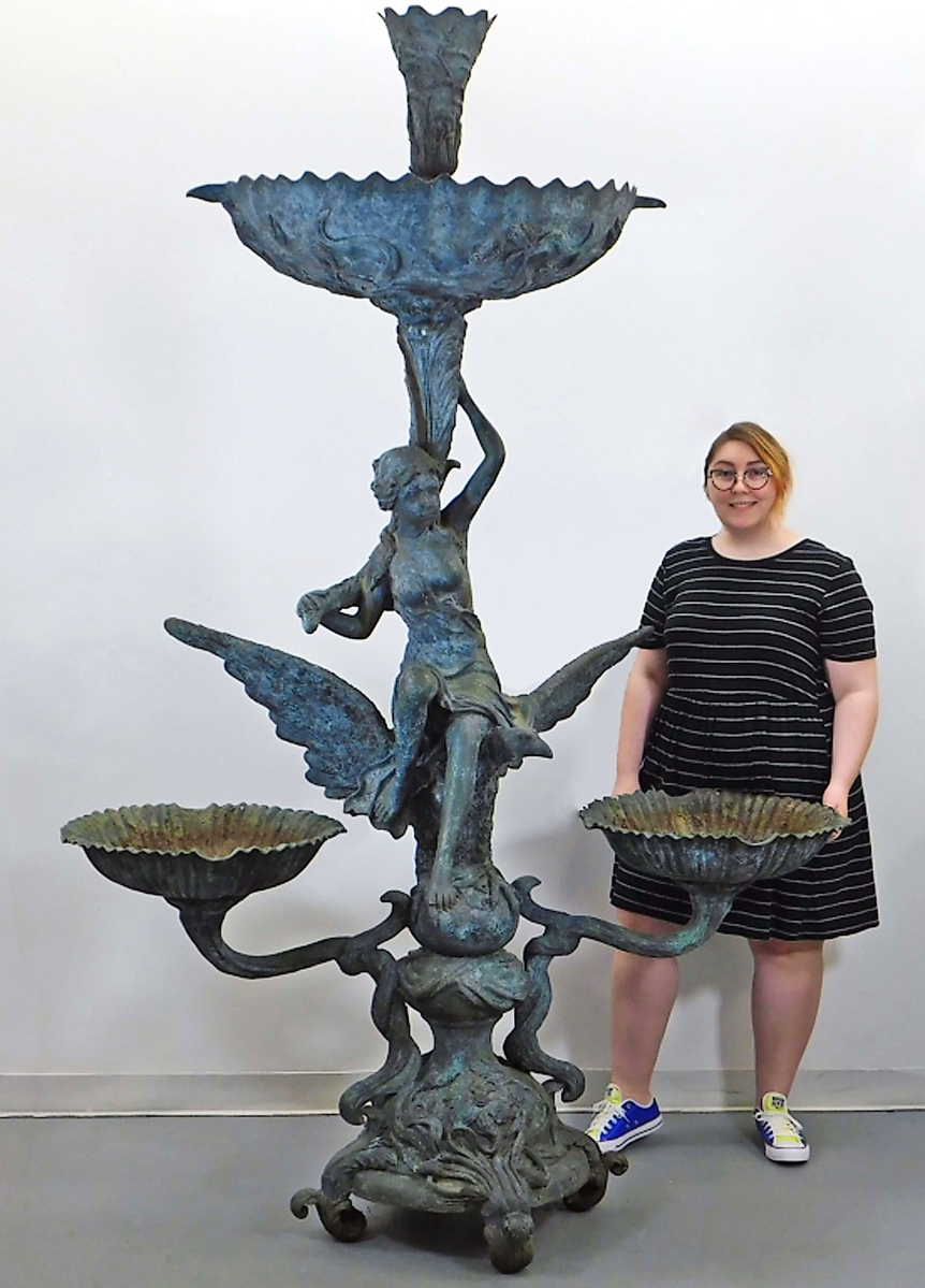 """Kevin Bruneau needed a few hands to help him remove this 92-inch-tall bronze fountain from the East Greenwich, R.I., yard it had been in. A buyer """"down south"""" paid $3,900 for it ($ ,000)."""