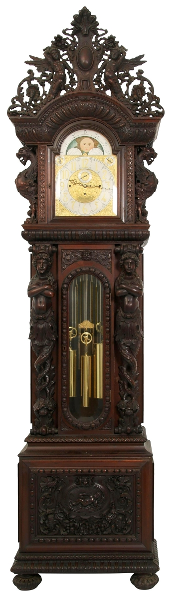 """This R.J. Horner & Co. (New York, 1886-1915) mahogany grandfather clock, circa 1890, sold for $63,525. The dial was signed """"Joseph Jennens, Skinner Street, Clerkenwell London,"""" and it had a movement with eight tubes, one signed """"Jos. J., London,"""" and a cathedral gong, signed """"Made in England."""" The case was alive with winged griffins, female caryatids, scrollwork, filigree and the crest with two maidens flanking a cartouche shield."""