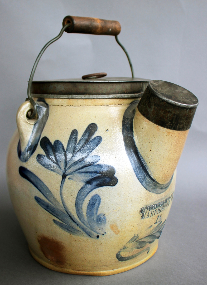 One could make a lot of pancakes from this Cowden & Wilcox stoneware batter jug with foliated grape decoration, which topped off at $7,392.