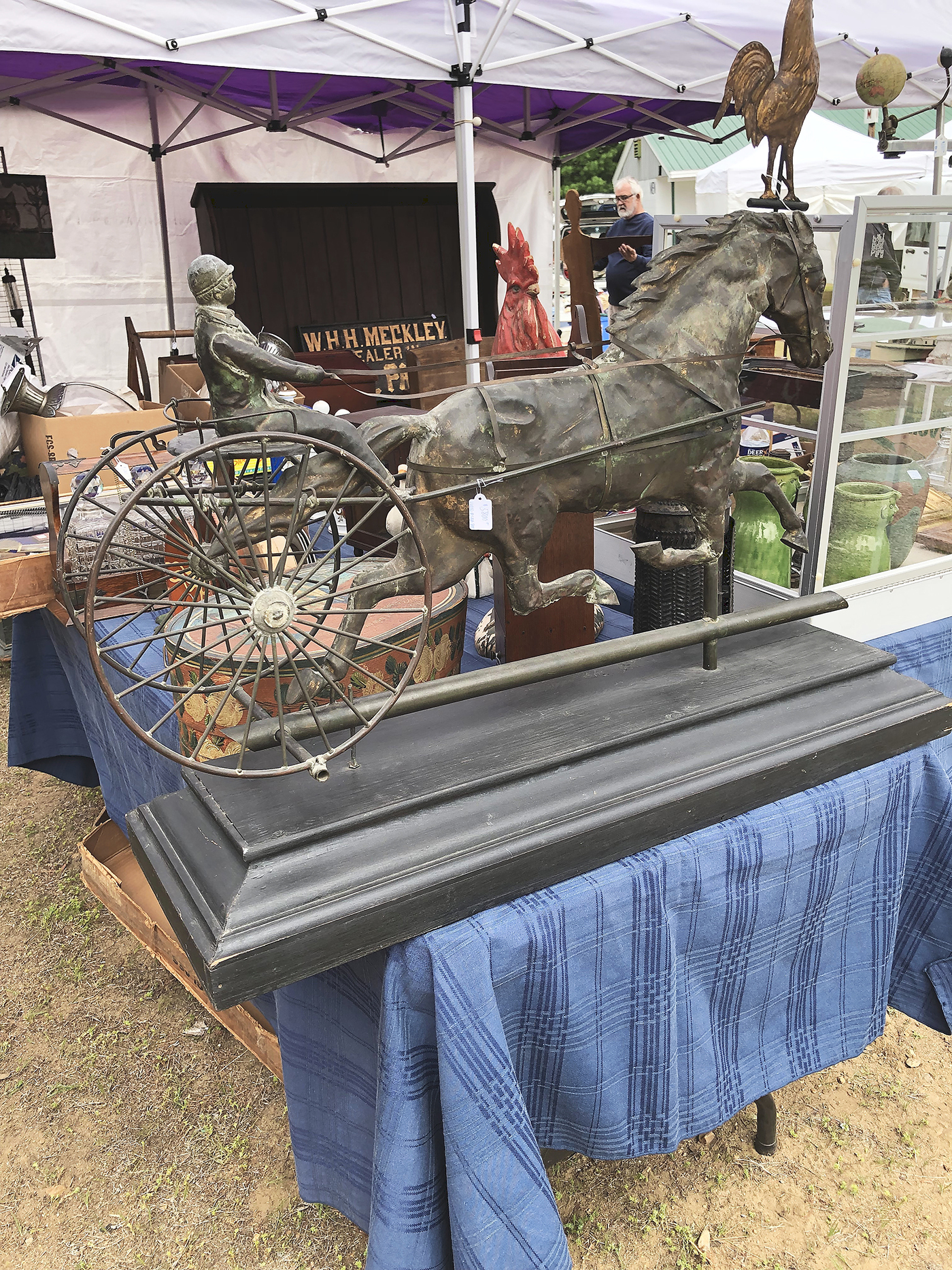 Steve Still, Manheim, Penn., brought a selection of folk art. The horse and sulky weathervane with a good surface was priced at $5,800. He also offered a very detailed watercolor of a New England mill town, with buildings, a train, a river and more, priced at $2,850.