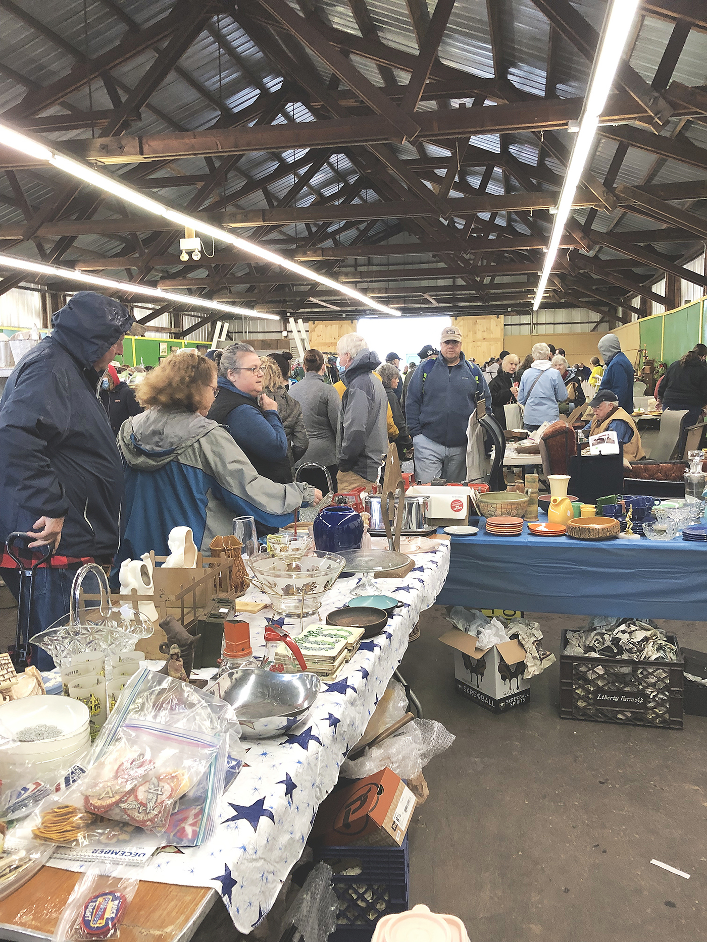The weather conditions did not keep many people away. The crowd, partially shown above on the first day, totaled just under 6,000. The second day brought another 3,200 buyers. Many younger buyers, some with strollers, were in the crowd.