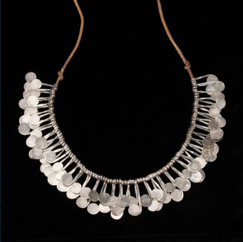 Among Modern art jewelry highlights was a silver fringed necklace, 30 inches long, attributed to Alexander Calder (American, 1898-1976). Selling for $75,000, more than ten times its high estimate, the hammered silver on cord was composed of twisted silver bands ending in scrolls, appearing as stylized silver musical notes.