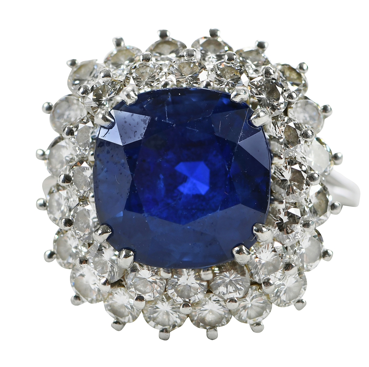 This Ceylon sapphire and diamond ring with cushion cut unheated blue sapphire surrounded by 36 brilliant diamonds led a substantial assortment of jewelry lots and sold to a phone bidder for $51,660 ($10/20,000).