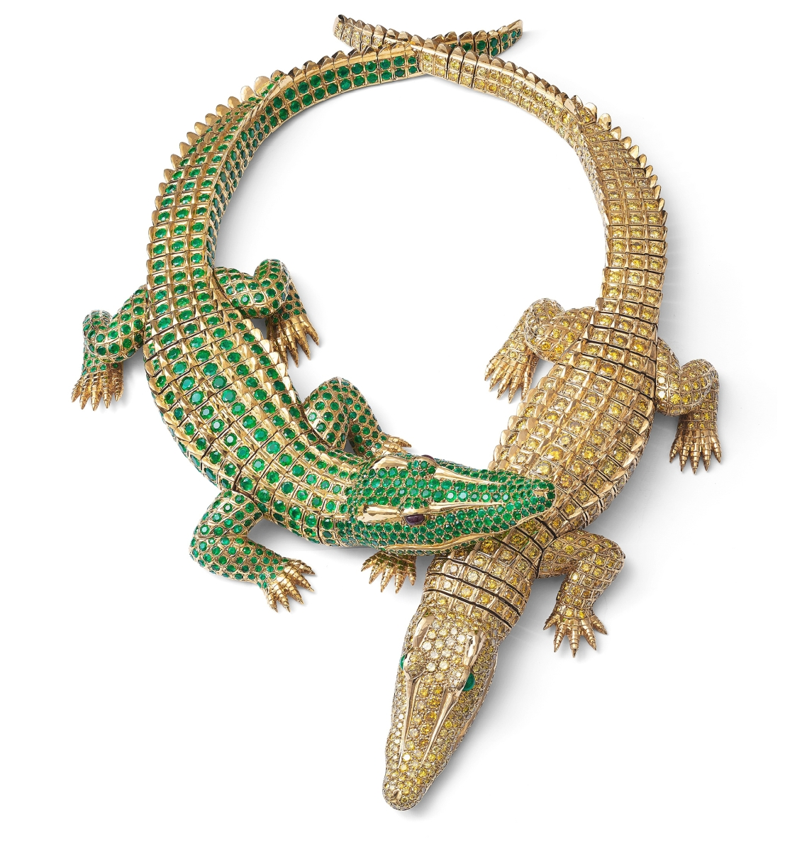 """According to legend, when actress María Félix commissioned this necklace, she carried live baby crocodiles into Cartier in Paris to serve as models for the design. The realistic sculpting of the gold includes the scutes of a crocodile's skin. There are 60.02 carats of fancy intense yellow diamonds and 66.86 carats of emeralds in the setting. From """"Beautiful Creatures."""" Credit: Nils Herrmann, Cartier Collection © Cartier"""