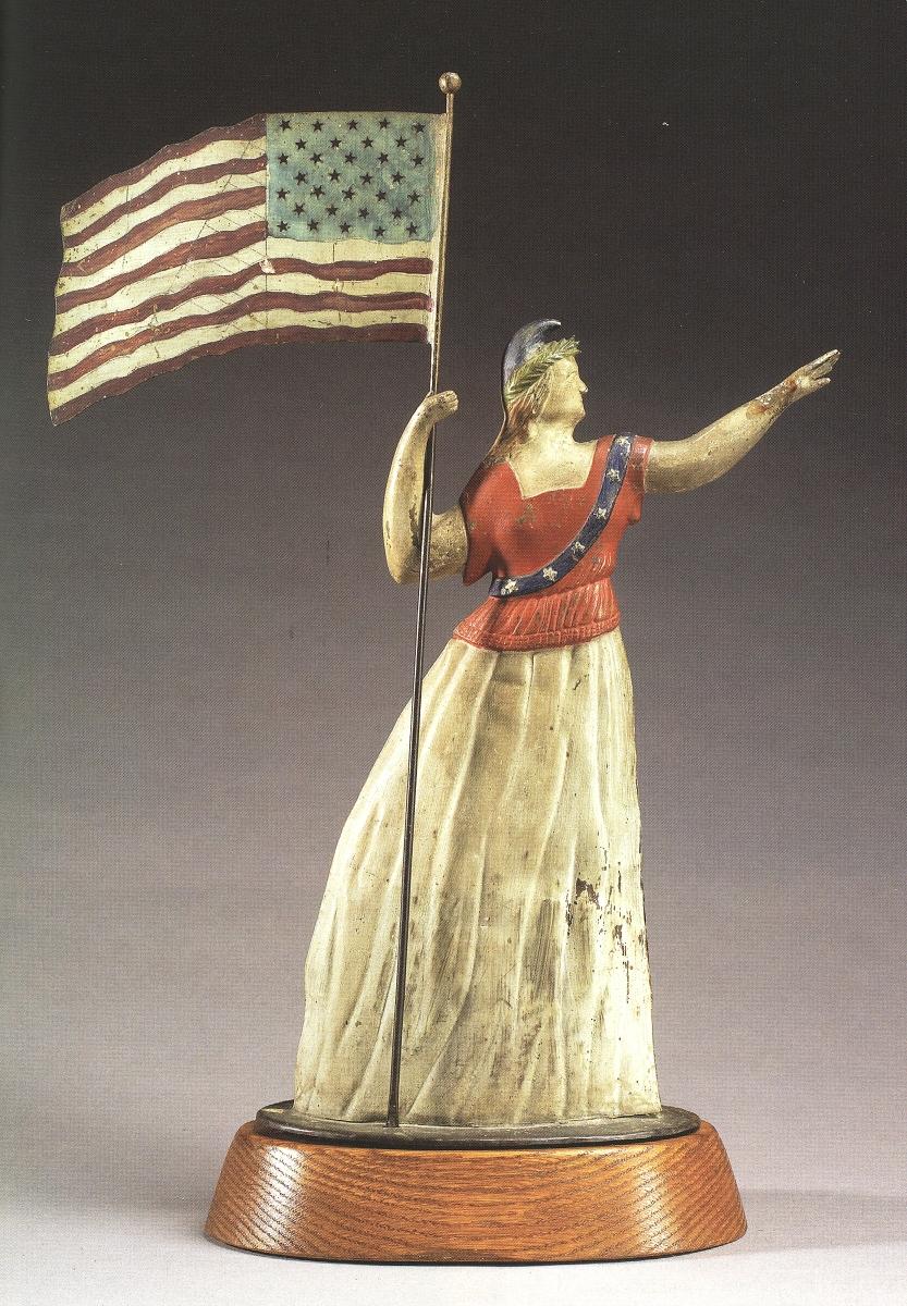 """""""Goddess of Liberty"""" by A.L. Jewell & Co., Waltham, Mass., 1865-67. Molded and sheet copper, molded zinc, paint, 20 by 15 by 2½ inches, depth at base 4½ inches. Collection of Bob and Becky Alexander."""