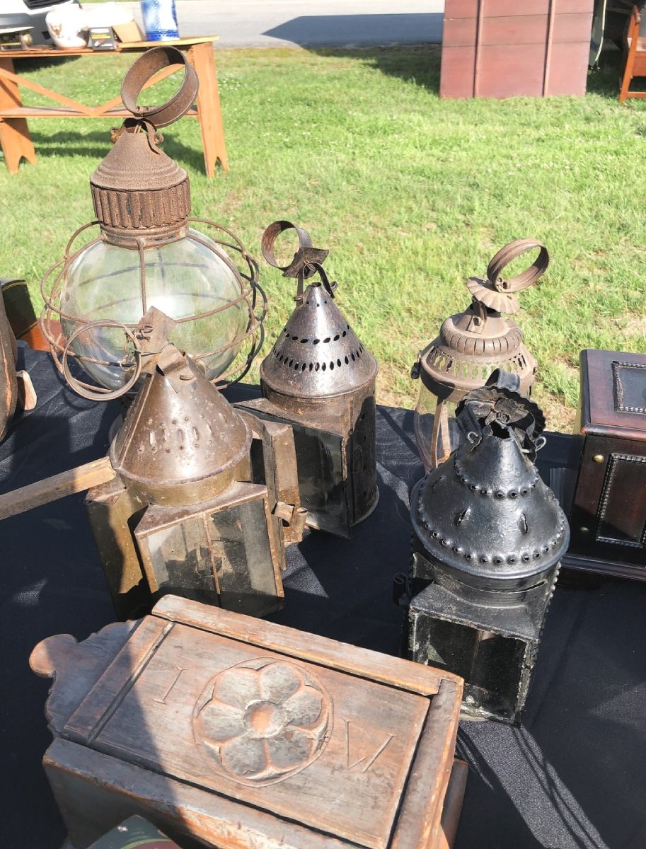 """Several dealers offered early lighting selections.  Josh Farrin, Randolph, Maine, had a particularly good group, including the early pewter and glass """"onion"""" lanterns priced between $ 275 and $ 400."""