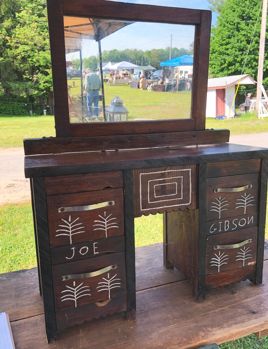 The miniature sideboard, decorated with trees and rectangles, was made by Joe Gibson of Georgia in the 1920s. Toni Lima, Damariscotta, Maine, was asking for only $ 125.  He didn't know any details about Gibson.