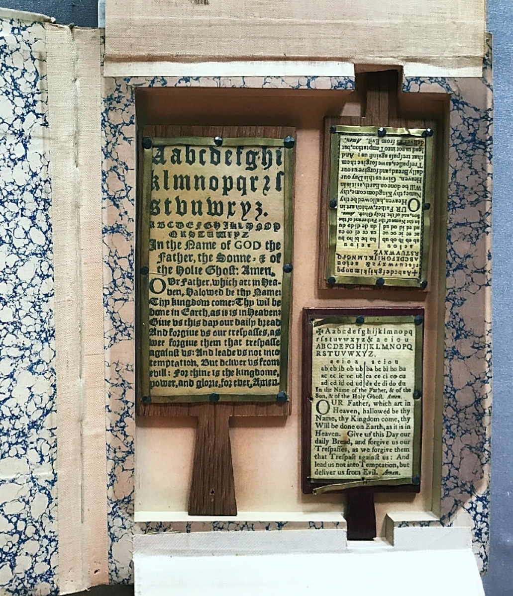 A Seventeenth Century English hornbook made of horn and paper was priced at $2,200 and still available. Kathleen Staples Fine Antique Textiles and Books, Greenville, S.C.