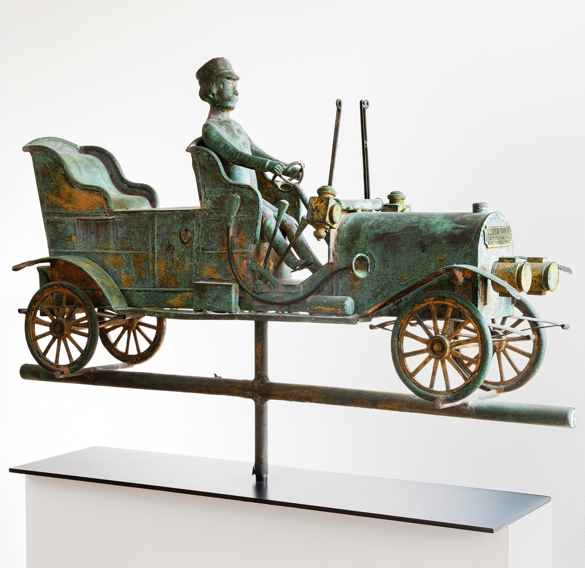Touring car and driver, W.A. Snow Iron Works, Boston, Mass., circa 1910. Molded copper with traces of gilt, height from bottom of wheels, 18 inches, length 33 inches. Collection of Susan and Jerry Lauren, photo Adam Reich.