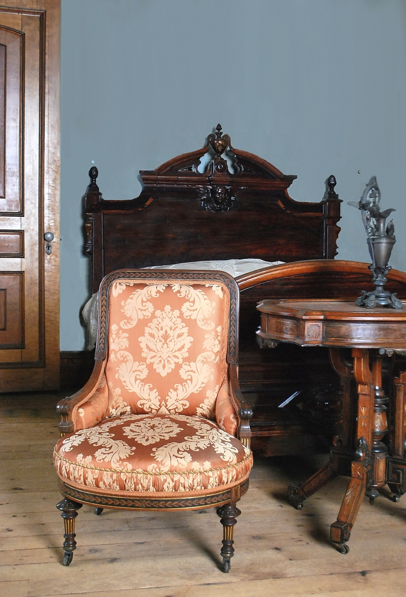 Herter Brothers bergere, bay leaf marquetry design with gilding, circa 1870s, gift of Joe Wiessinger, photo courtesy Lockwood-Mathews Mansion Museum.