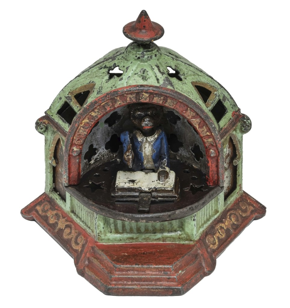 The best-selling lot was this Kyser & Rex Chimpanzee Iron Mechanical Bank which sold for $ 26,400.  The well-dressed chimpanzee sits at his desk and conscientiously records every deposit made in his ledger.