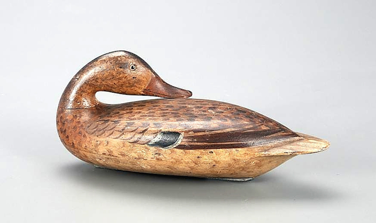 Carved by Robert Elliston and painted by his wife Catherine, this preening mallard hen earned $100,200. The decoy was extensively described and illustrated in Masterworks of The Illinois River and was included in a 2005 exhibition of those decoys.
