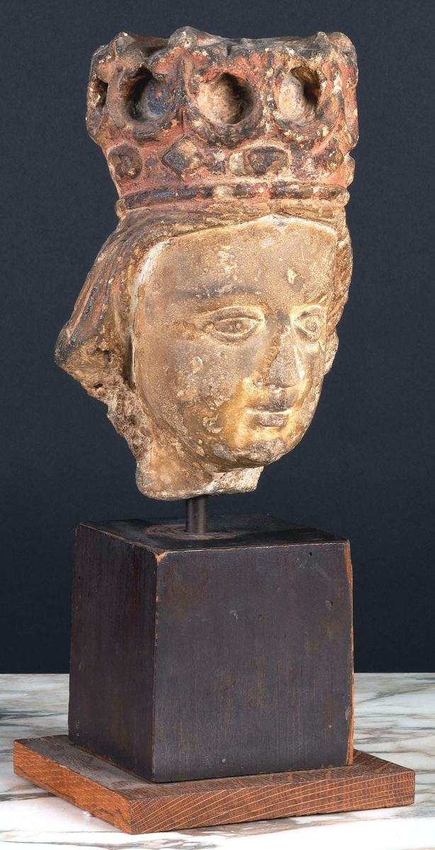 A French Gothic limestone head of a king raised on an ebonized and wood base took $6,500.