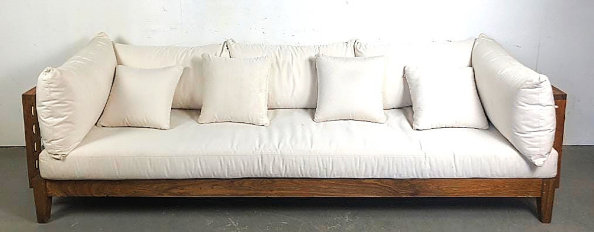 This teak upholstered sofa with leather netting inside the panels, retailed by Bergdorf Goodman, was the top lot of the sale, going out at $4,063.