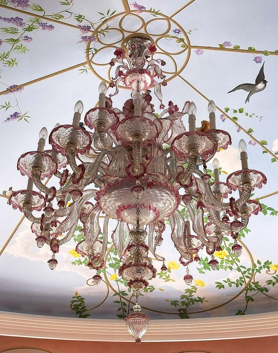 Amazingly well-preserved considering its form and the fact that it's all glass, this Venetian glass 16-light chandelier in clear glass with pink accents and multicolored flowers was a survivor and was bid to $5,625.