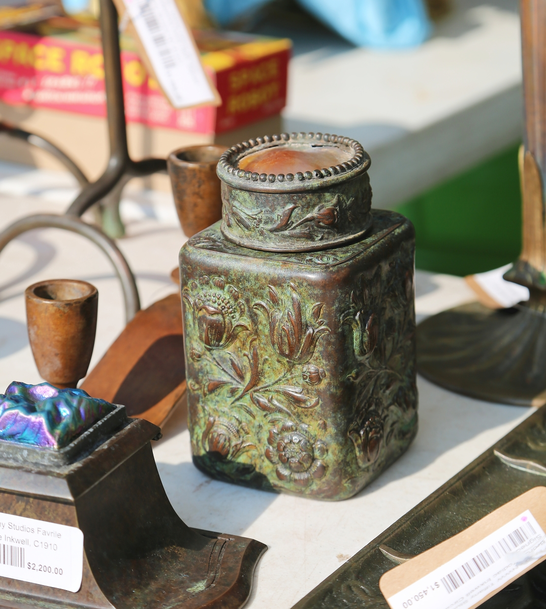 A Tiffany Studios bronze scent jar with inset turtleback glass lid was found with Antique Revival, Big Flats, N.Y.   —May's Antique Market