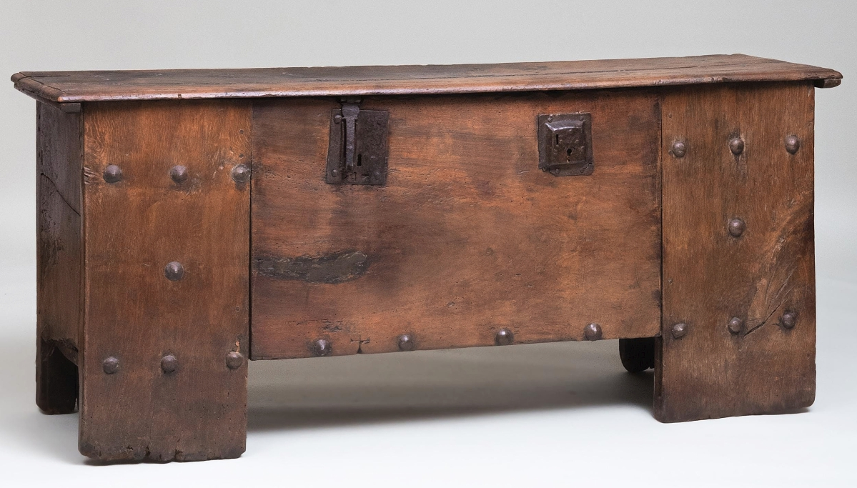 """""""Stollentruhe"""" in German means studded chest. This iron-studded oak example from the Westphalia region finished at $6,500 against a $1,5/3,000 estimate. It opens to a welled interior and measures 31½ by 72 by 20½ inches."""
