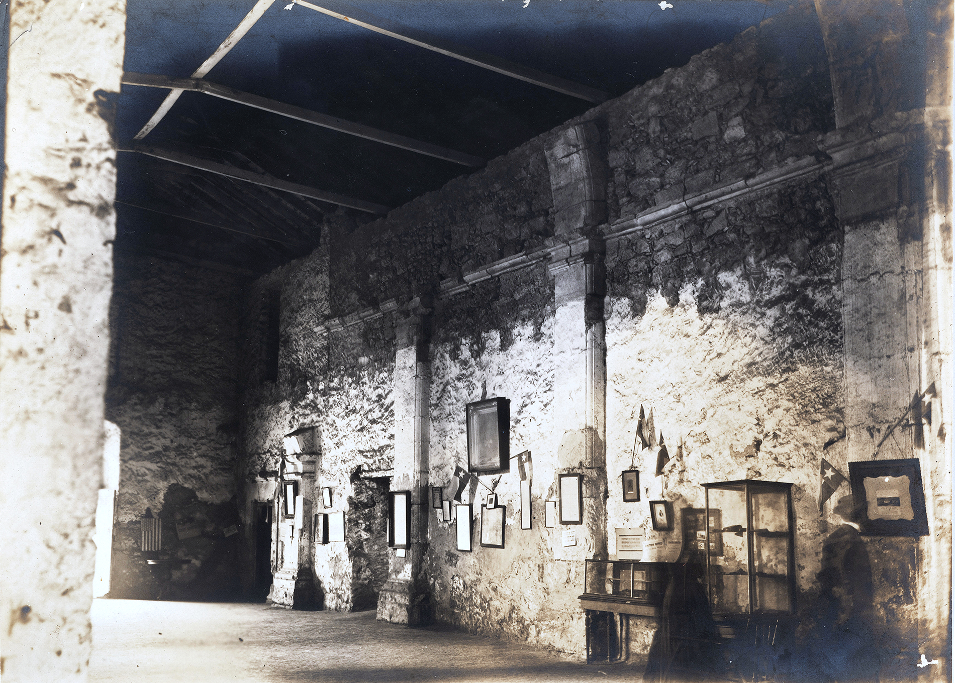 A photo of the interior of the Alamo church from the 1910s. Adina Emilia De Zavala Papers, The Dolph Briscoe Center for American History, The University of Texas at Austin.