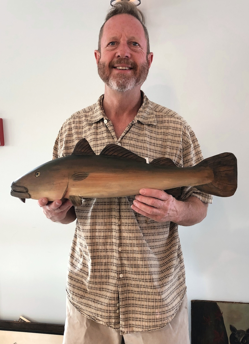 Tom Reiley, the show manager, had several decoys for sale, including this carved and painted codfish, about 2 feet long. It came from a Cape Cod restaurant where it was probably a sign, and it was priced $325.