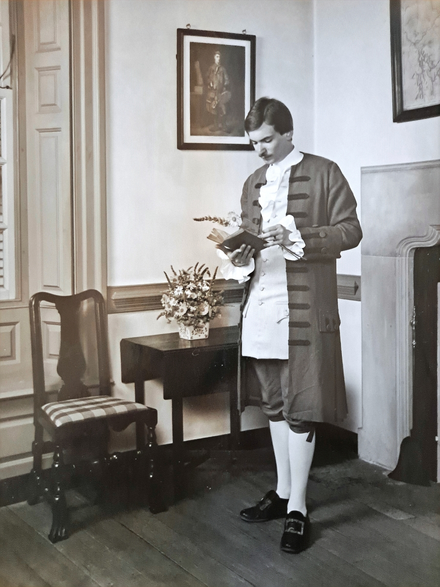 Savage worked as a costumed interpreter at Colonial Williamsburg during his undergraduate years at the College of William and Mary. This photograph was taken in 1976 at CWF's Wythe House.