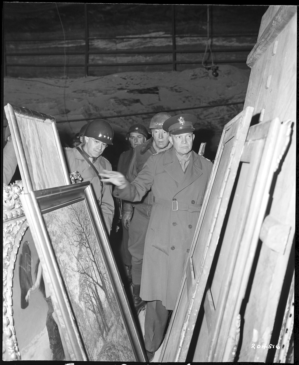 Generals Dwight D. Eisenhower, Omar N. Bradley and George S. Patton inspect art found in the Merkers salt mine, April 12, 1945. Image courtesy of National Archives at College Park, Md.