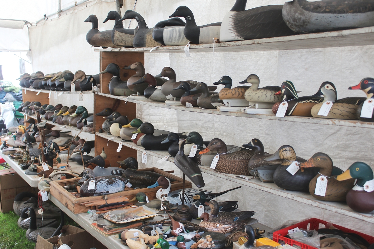 Ronald Zelnick, Altamont Springs, Fla., had brought paperweights, estate jewelry and vintage fishing lures to Brimfield; his wall of vintage decoys made a striking presentation.             —New England Motel