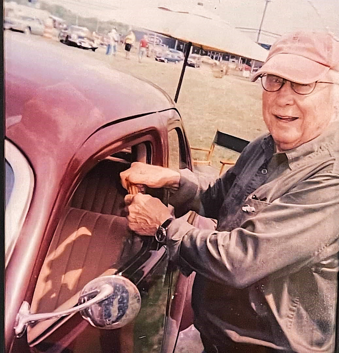 Keno standing next to his Cord 812 Supercharged Beverly painted in 1937 brown.