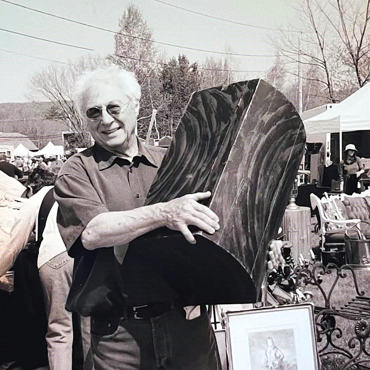 Keno is seen here in an undated photo at the Brimfield Flea Market with a boldly painted pine domed first trunk.