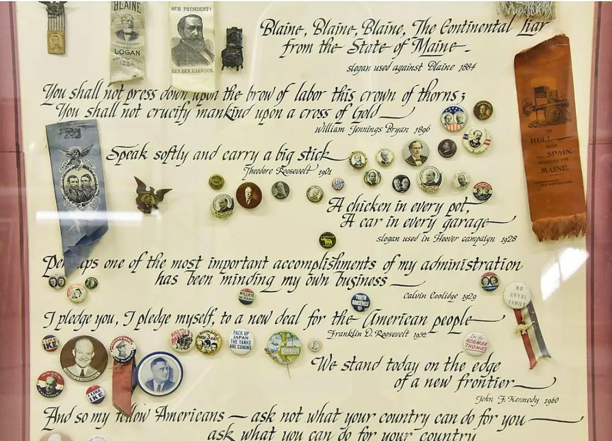A detail image of the political memorabilia presentation case reveals a selection of the buttons and ribbons within. The whole case sold for $3,437.