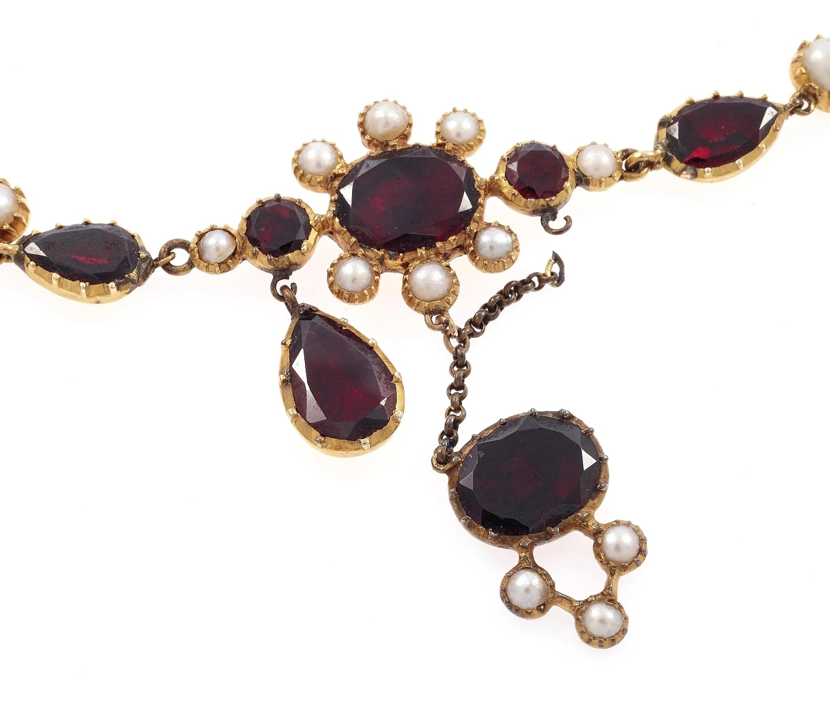 """""""The customer had my garbage can pulled out and was going to toss it because it was broken,"""" said Holly Anderson-Pree on this Georgian garnet, pearl and yellow gold necklace. It dated more than 200 years old and featured some breaks, which the specialist said is common for works of that age. The necklace made its way to the auction block instead, where it sold for $1,680."""