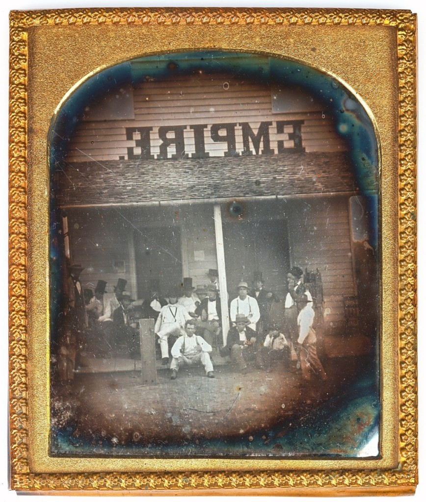A sixth-plate daguerreotype documenting a group of men gathered outside the storefront of the Empire was taken by bidders to a final price of $5,664 against a $500-$1,500 estimate.