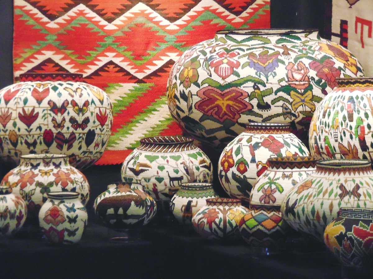 Canyon Road Gallery owner Michael Smith, Santa Fe, supports the Wounan People's effort to preserve their tribal lands in the Panamanian rainforest by helping sell their exquisite baskets.