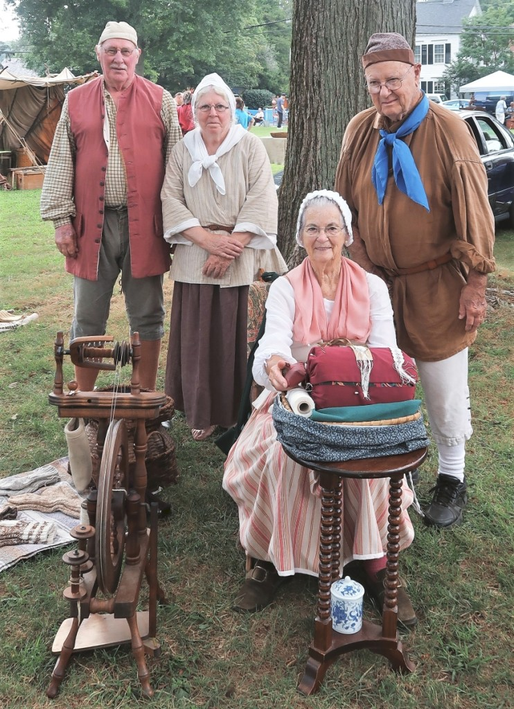 Lynne White, seated, and her husband, Buster, right, with Neil and May Muckenhoupt. The four friends are historic reenactors who travel to events around New England and upstate New York.