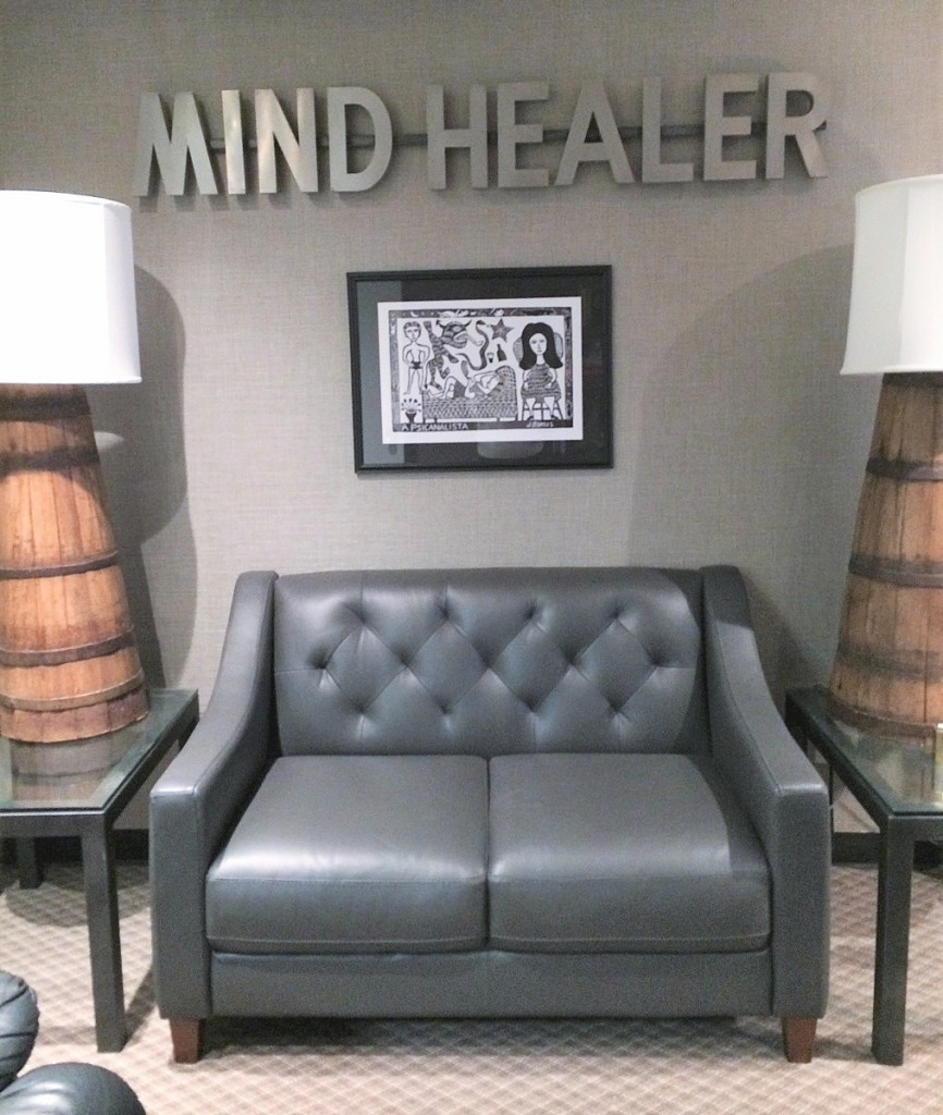 """""""Mind Healer"""" sign over a woodcut   depicting a patient in therapy."""