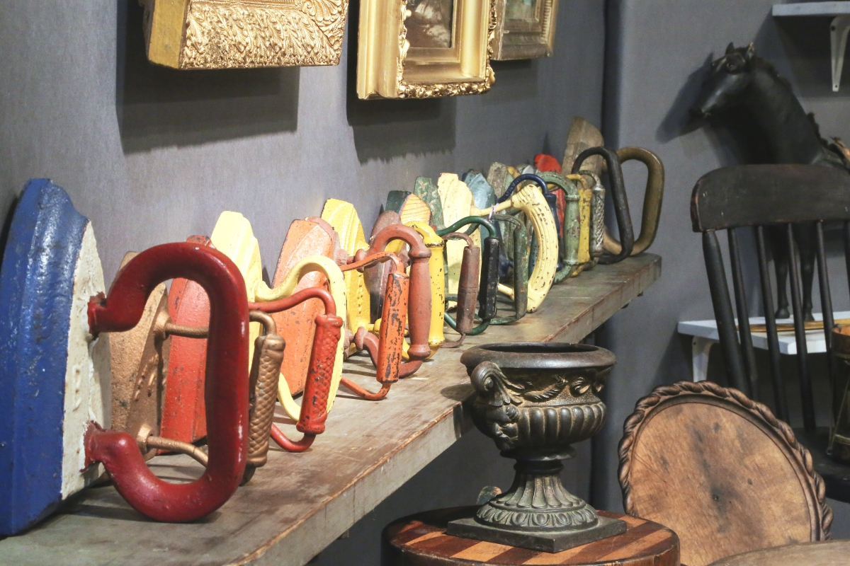 From the late Nineteenth/early Twentieth Century, this collection of 18 colorfully painted sad irons in Josh Steenburgh's booth warranted their own shelf.