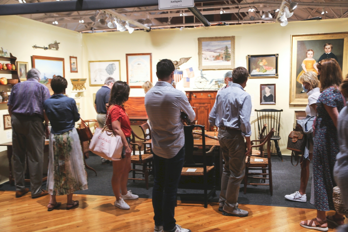 Admiring, acquisitive crowd zeroes in on the collection of Jeffrey Tillou.