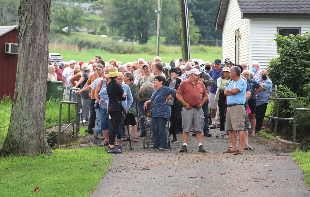 The gate just prior to the opening saw a horde of hungry buyers.