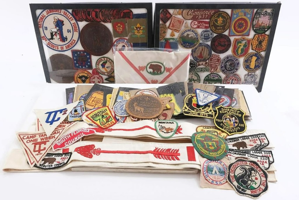 Selling for $1,169 was a large group of vintage patches and awards for the Boy Scouts of America and Girl Scouts of America ($100/200).