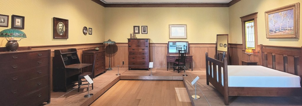 Visitors to MAACM's galleries have the rare opportunity to experience a variety of immersive Arts and Crafts Movement installations. Room recreations, such as this period bedroom, combine select collection pieces to surround visitors in a complete Arts and Crafts environment.