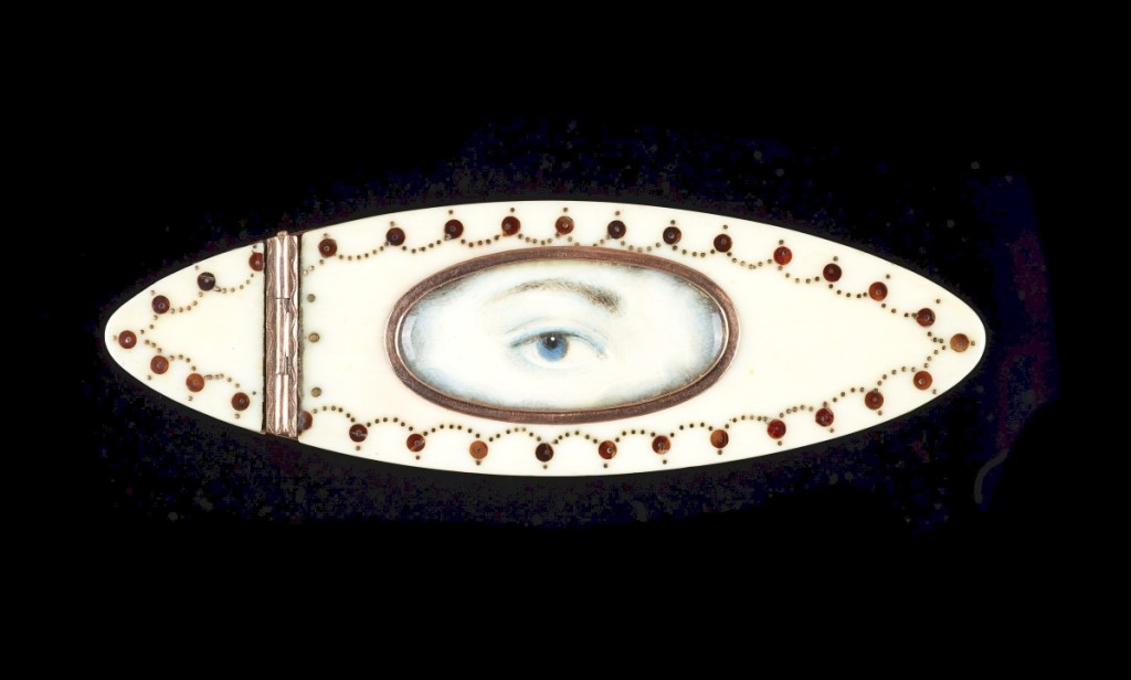 Ivory toothpick case with gold piqué embellishment, hinged lid and burgundy velvet interior,   circa 1890, lady's blue right eye with blue and gray clouds at the edges.   Dimensions:   by 15/16 by 5/16 inches.