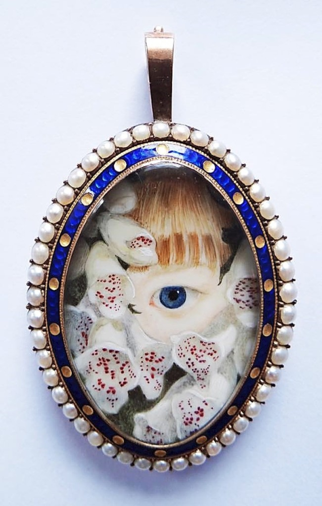 Eye of Mary Sarah Fox, enveloped in foxgloves,   set in a gold frame with seed pearl and   guilloche border, circa 1835.