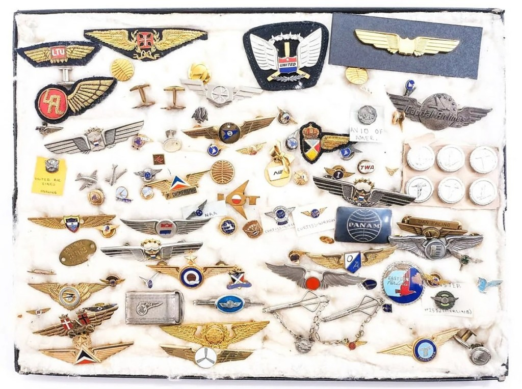 Online competition propelled this group lot of more than 70 airline pins and collectibles to $1,968. Ryan Brechlin said the original — rather than souvenir or junior — pilots and stewardess wings helped drive interest in the lot ($ ,000).